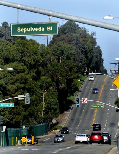 Old Sepulveda Blvd street sign seen at 8 AM, looking west on El Segundo Blvd., before being replaced two hours later.   As the City of El Segundo changes it's appeal as a beach city, a two mile stretch of Sepulveda Blvd through town is being changed to Pacific Coast Highway, Saturday, June 1, 2018.  (photo by Mike Mullen